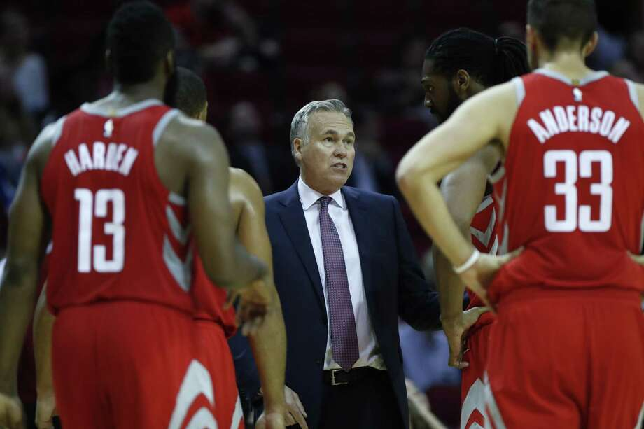 Mike D'Antoni, center, is running an offensive system with the Rockets that doesn't quite look the same as the one he made famous during his largely successful tenure with the Suns. Photo: Karen Warren, Staff / Houston Chronicle / © 2017 Houston Chronicle