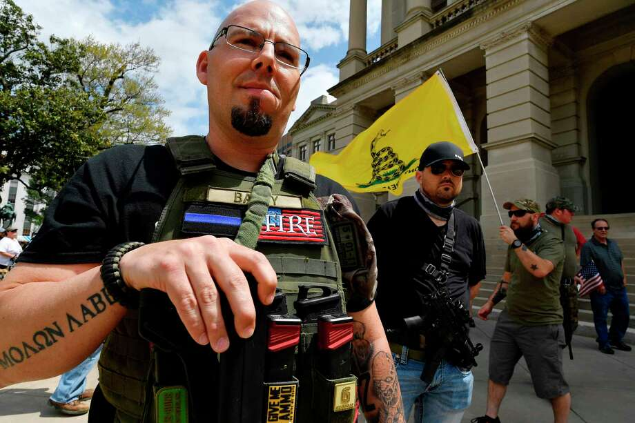 Shaun Baby, of Cartersville, Ga., participates in a gun-rights rally at the state capitol, Saturday, April 14, 2018, in Atlanta.  About 40 gun rights supporters have gathered for one of dozens of rallies planned at statehouses across the U.S.   (AP Photo/Mike Stewart) Photo: Mike Stewart / Copyright 2018 The Associated Press. All rights reserved.