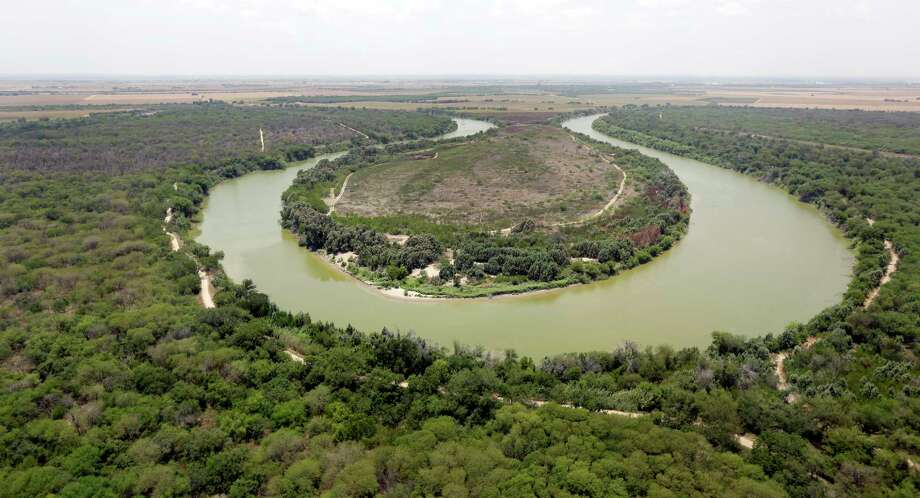 FILE - In this July 24, 2014, file photo, a bend in the Rio Grand is viewed from a Texas Department of Public Safety helicopter on patrol over in Mission, Texas. As hundreds of National Guard troops deploy to the U.S-Mexico border, residents of Texas' southernmost border region are fearful of the impact President Donald Trump's border wall will have. The troops patrolling the Rio Grande will eventually withdraw, but a wall could change the river forever. (AP Photo/Eric Gay, Pool, File) Photo: Eric Gay / Copyright 2018 The Associated Press. All rights reserved.