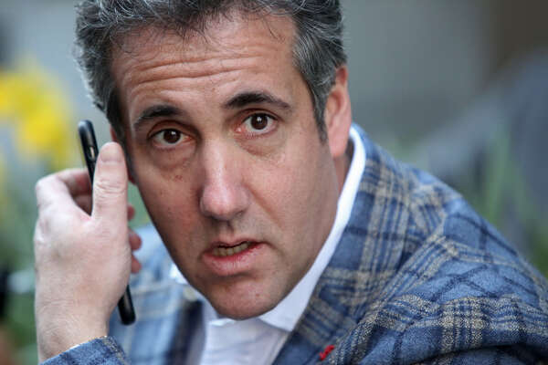 Michael Cohen, U.S. President Donald Trump's personal attorney, takes a call near the Loews Regency hotel on Park Ave on April 13, 2018 in New York City. Following FBI raids on his home, office and hotel room, the Department of Justice announced that they are placing him under criminal investigation. (Photo by Yana Paskova/Getty Images)