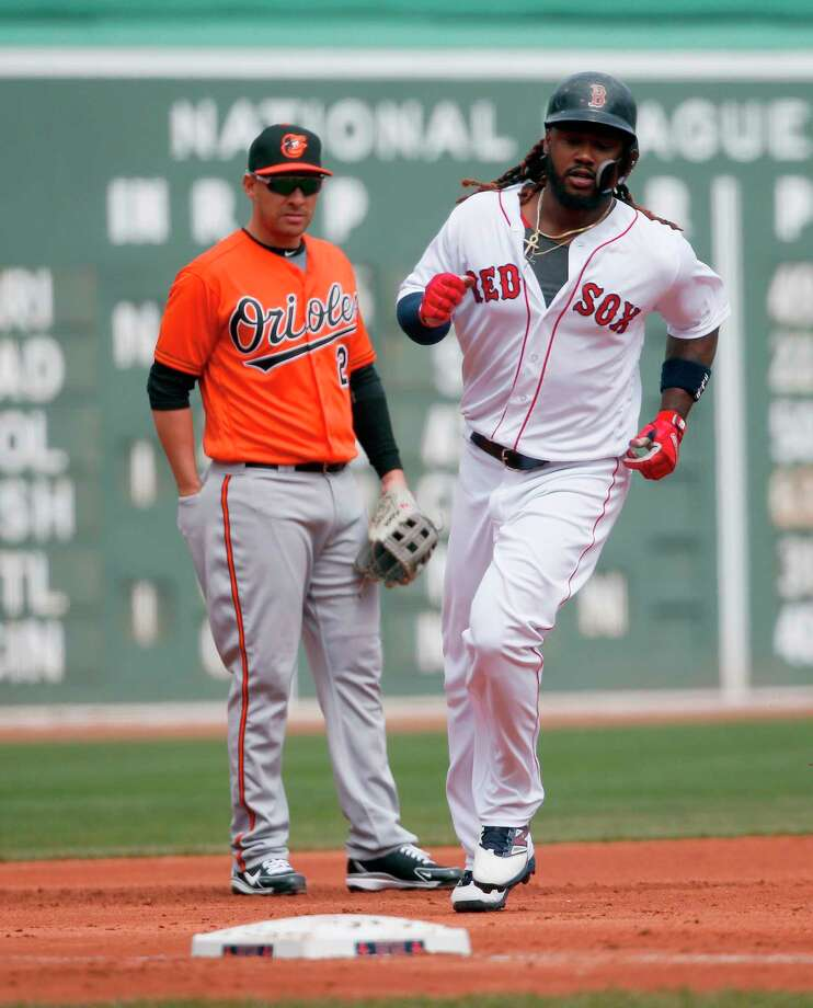 Boston Red Sox's Hanley Ramirez, right, rounds third base in front of Baltimore Orioles' Danny Valencia (2) on his two-run home run during the first inning of a baseball game in Boston, Saturday, April 14, 2018. (AP Photo/Michael Dwyer) Photo: Michael Dwyer / AP2018