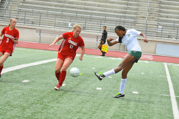 Kingwood Park player Allie Byrd (18) kicks the winning goal to win regionals against Tomball.