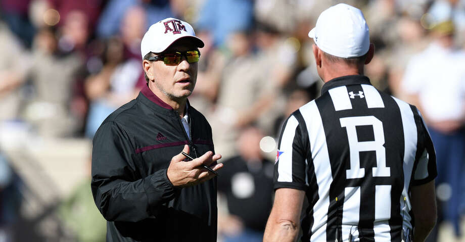 Texas A&M head football coach Jimbo Fisher, left, speaks with an official during the first half of Saturday's Maroon & White game at Kyle Field. Photo: Eagle Photo By Laura McKenzie