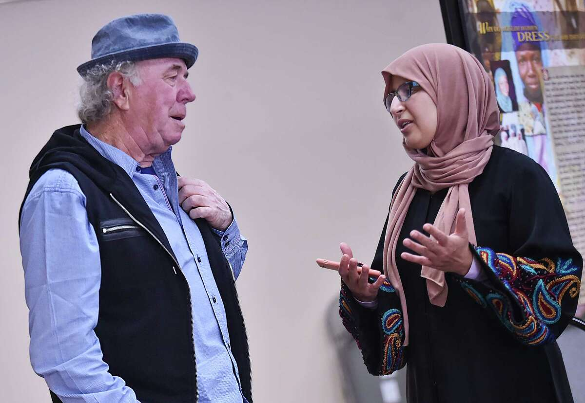 Karima El-Hamraoui TAROUA, of Morocco talks to Greek immigrant Georgios Psiantos about his vision of Islam today in the U.S. and Europe at the first 'Meet your Muslim Neighbor' at the New Haven Islamic Center at 254 Bull Hill Lane in Orange, Saturday, April 14, 2018.