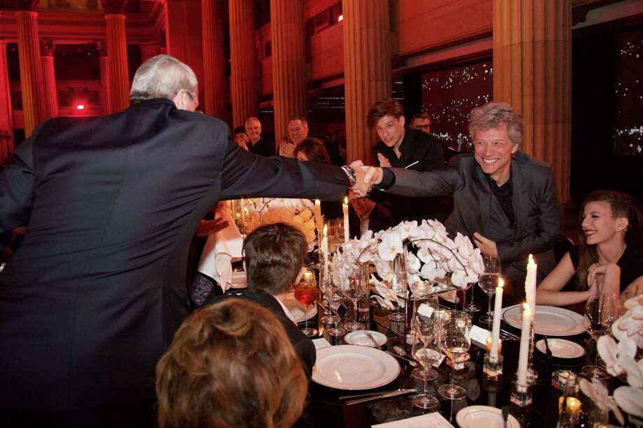 "In this  photo provided by David Bergman, New Jersey Gov. Phil Murphy shakes hands with Jon Bon Jovi during a dinner in Cleveland,  on Friday April 13, 2018, the night before the band was to be inducted into the Rock & Roll Hall of Fame.  Murphy issued a proclamation on Saturday April 14,  naming the day ""Bon Jovi Day"" in New Jersey.  (David Bergman via AP) Photo: David Bergman / Photo (c) 2018 David Bergman"