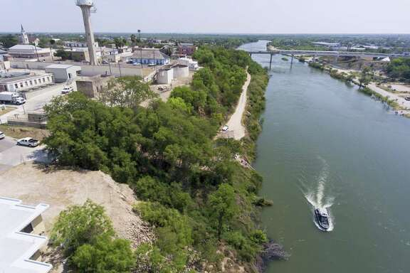 The Rio Grande runs past Roma, Texas Tuesday, March 27, 2018 which sits on a high bank of the river that marks the border between the U.S. and Mexico. It is expected a portion of President Trump's border wall will run along the steep cliff but exact locations for the first stages of the expanded wall have not been published by the government.
