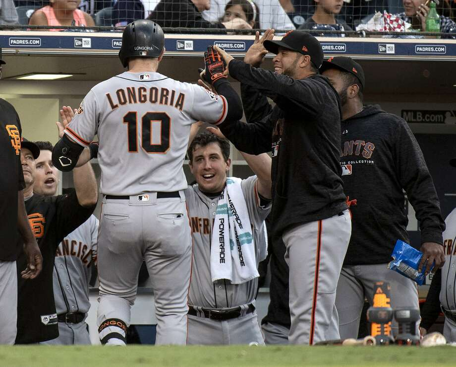 San Francisco Giants' Evan Longoria (10) is welcomed at the dugout after hitting a two-run home run during the fourth inning of a baseball game against the San Diego Padres in San Diego, Saturday, April, 14, 2018. (AP Photo/Kyusung Gong) Photo: Kyusung Gong / Associated Press