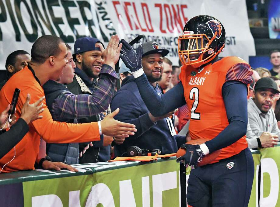 Albany Empire's #2 Greg Carr is congratulated by fans after scoring a touchdown in the Empire's Arena Football League debut against the Philadelphia Soul to a packed house at the Times Union Center Saturday April 14, 2018 in Albany, NY.  (John Carl D'Annibale/Times Union) Photo: John Carl D'Annibale / 20043464A