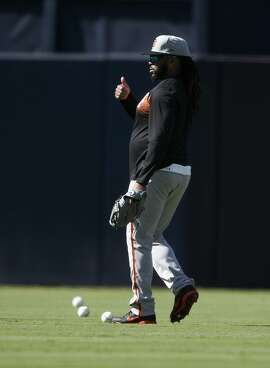 San Francisco Giants pitcher Johnny Cueto works out prior to a baseball game against the San Diego Padres in San Diego, Thursday, April 12, 2018. (AP Photo/Kelvin Kuo)