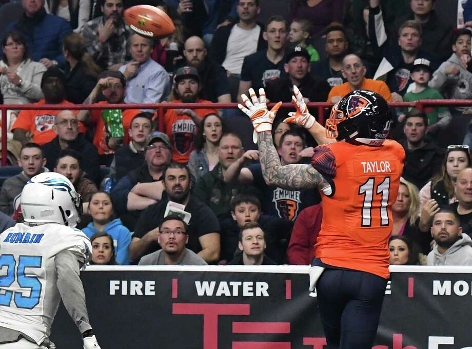 Albany Empire's #11 Collin Taylor, right, beats out Philadelphia Soul's # 25 James Romain to complete a touchdown pass in his team's Arena Football League debut at the Times Union Center Saturday April 14, 2018 in Albany, NY.  (John Carl D'Annibale/Times Union) Photo: John Carl D'Annibale / 20043464A