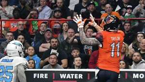 Albany Empire's #11 Collin Taylor, right, beats out Philadelphia Soul's # 25 James Romain to complete a touchdown pass in his team's Arena Football League debut at the Times Union Center Saturday April 14, 2018 in Albany, NY.  (John Carl D'Annibale/Times Union)