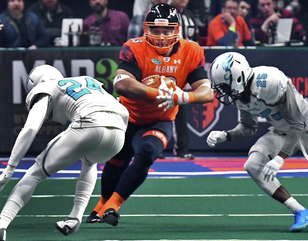 Albany Empire's #13 Wes Maula, center, runs into Philadelphia Soul defenders in the Empire's Arena Football League debut at the Times Union Center Saturday April 14, 2018 in Albany, NY. (John Carl D'Annibale/Times Union)