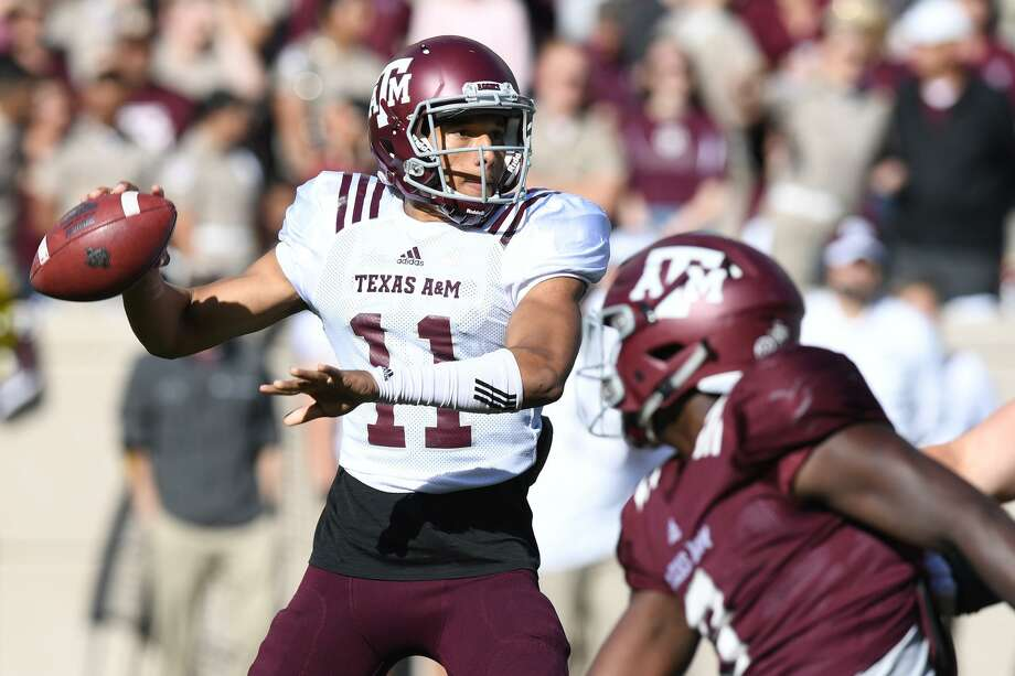 Quarterback Kellen Mond, left, completed 19 of his 26 passes for just 180 yards, but he threw for three touchdowns. Photo: Eagle Photo By Laura McKenzie