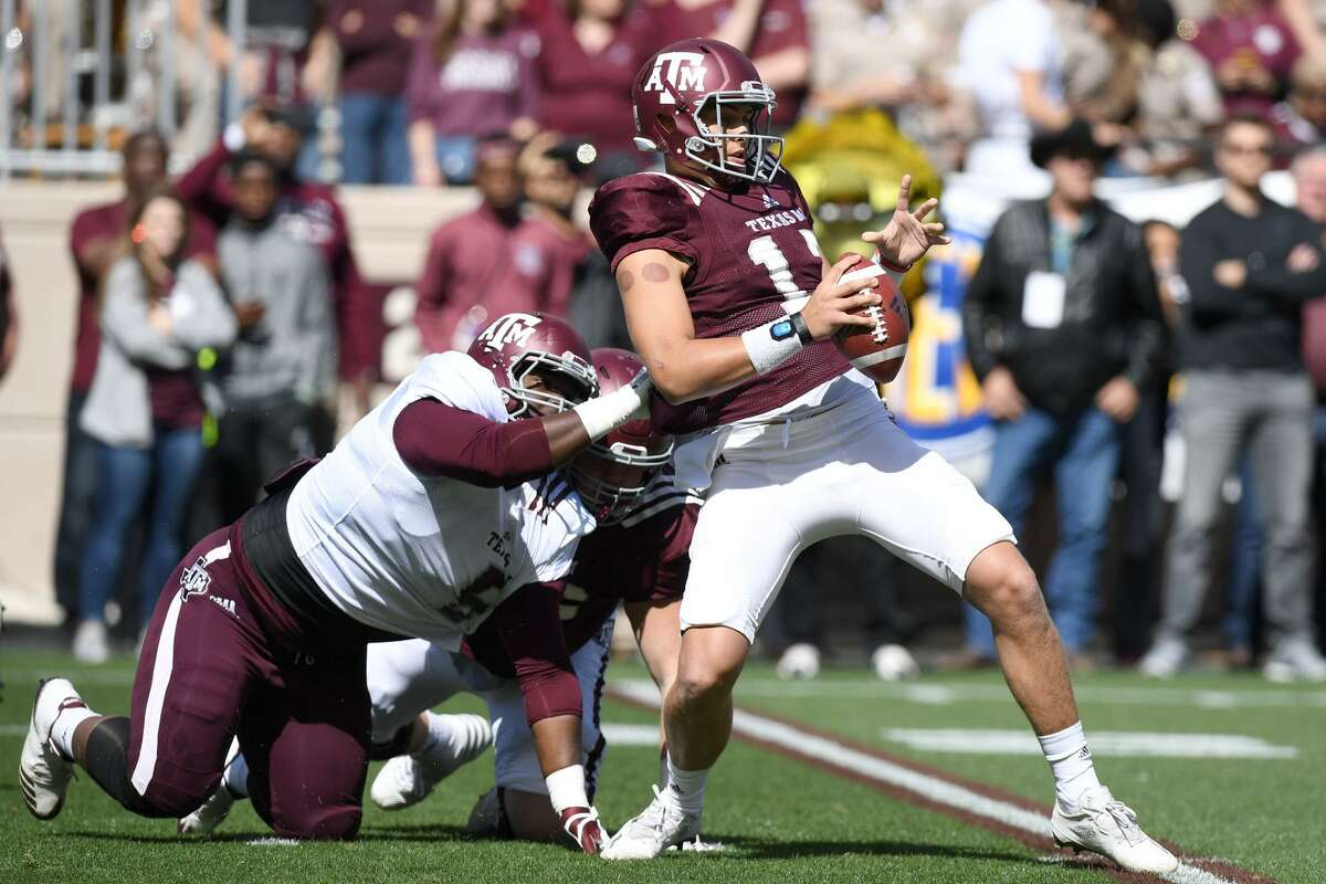 Texas A&M defensive tackle Daylon Mack, left, hopes he'll have more moments of getting after quarterbacks this season, much like he pressured the Aggies' Nick Starkel, right, on this play during A&M's spring game in April.