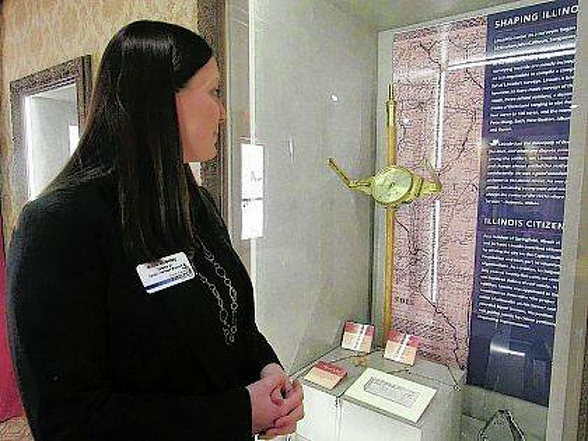 Anne Moseley, director of the Lincoln Heritage Museum, looks over a new exhibit,