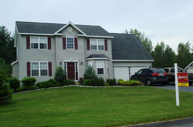 This Colonial at 15 Apple Tree Lane has four bedrooms and 2.5 bathrooms. It is on the market for $284,900. (Michael Lisi / Special to the Times Union)