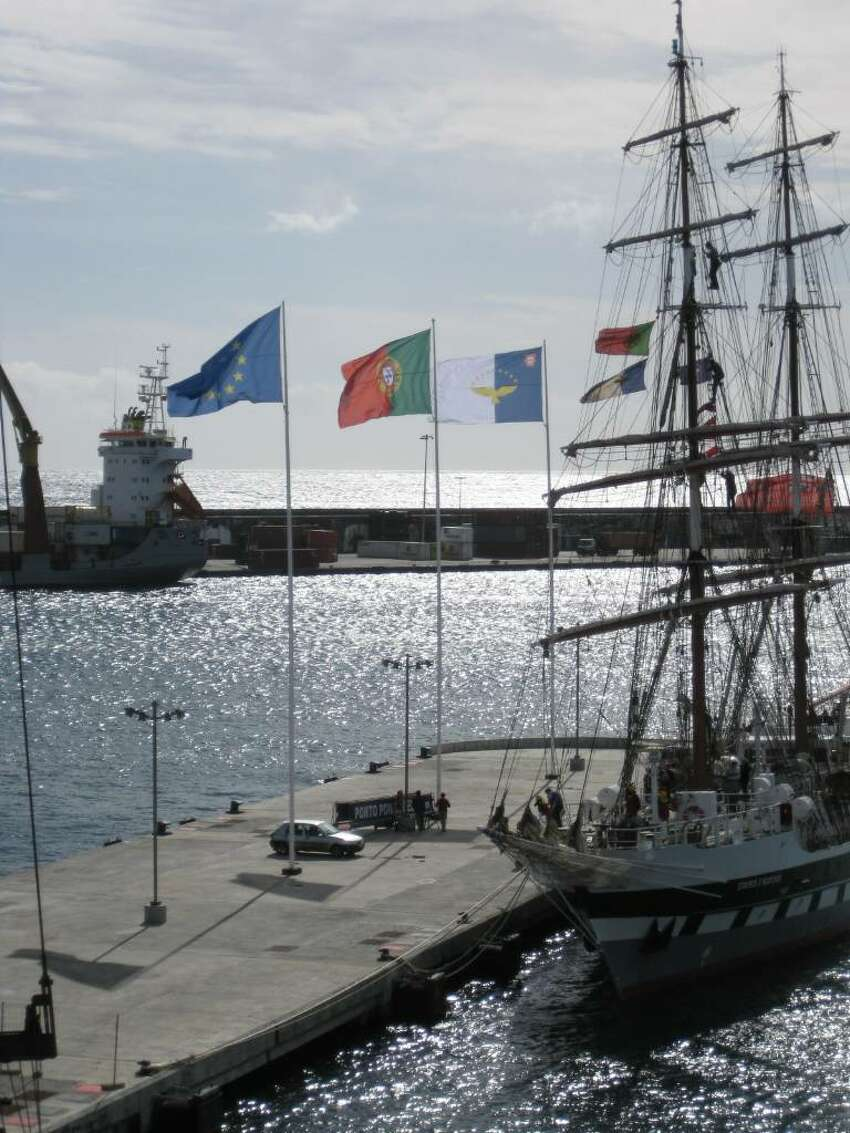 The modern harbor area of Ponta Delgada hosts not only cruise ships and commercial vessels, but is also the home port of the Portuguese navy?s tall ship. The three flags flying are, from left, those of the European Union, Portugal and the Azores. (K.D. NORRIS)