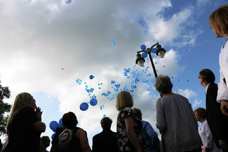 Blue balloons rise toward the sky as supporters gathered to remember victims of child abuse at city hall in Liberty. More than 100 were present to participate in the annual release of balloons and participate in the vigil. Photo: David Taylor / David Taylor