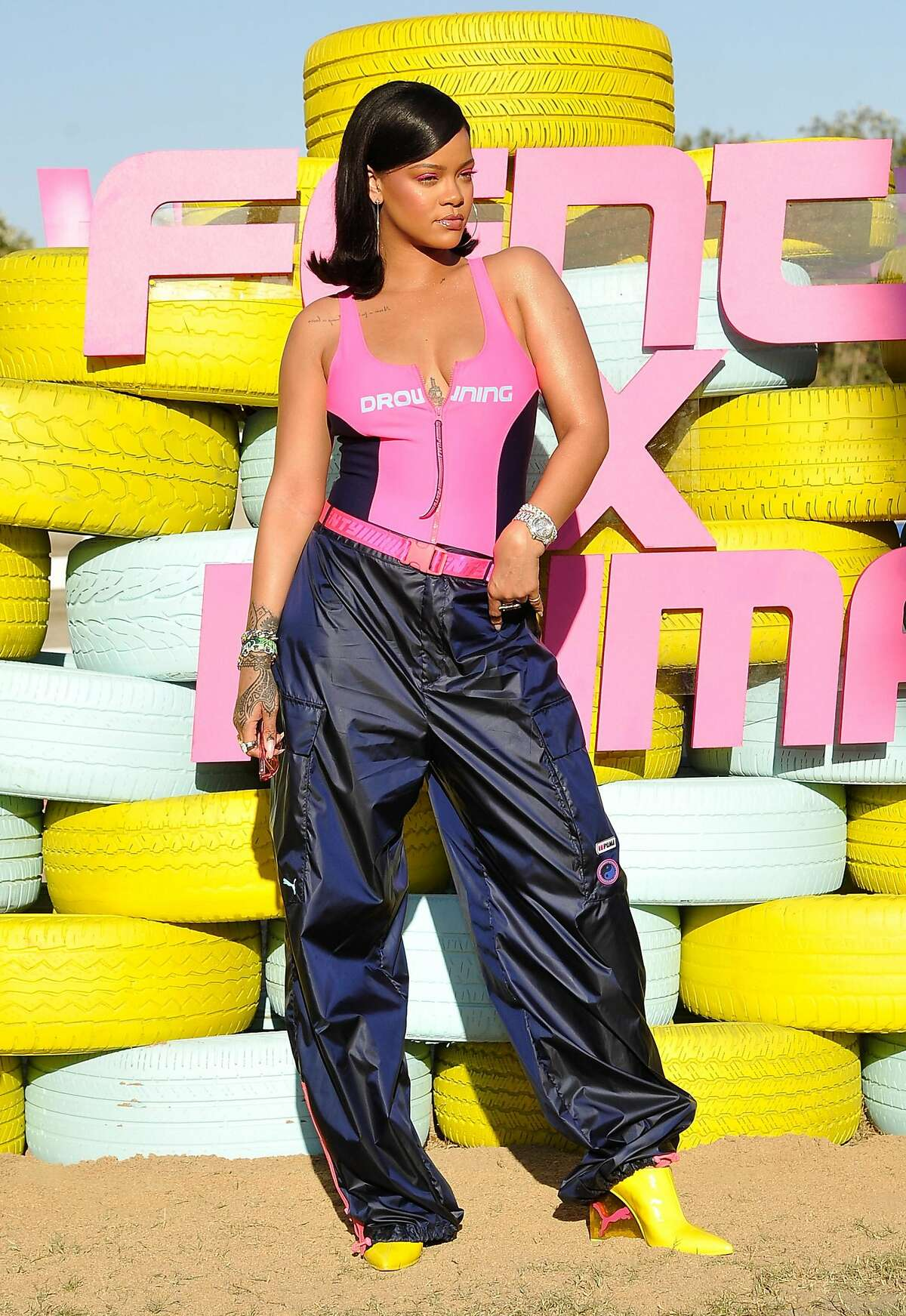 Rihanna attends the FentyXPUMA Drippin event launching the Summer '18 collection at Coachella on April 14, 2018 in Thermal, California.