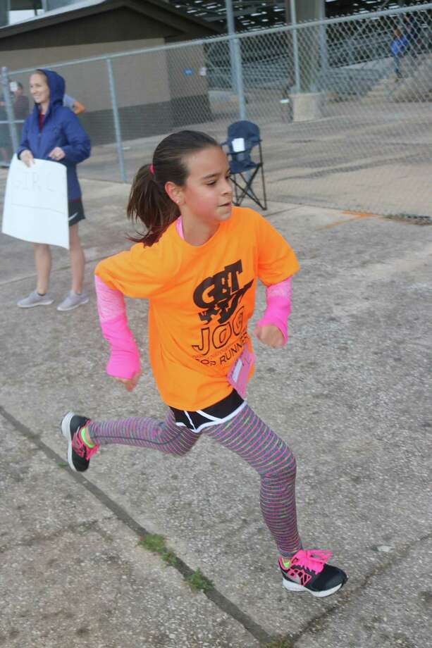 Hope Ortiz of Melillo heads for the inside of Ross Kelley Arena during Saturday morning's 40th annual Get Fit Jog. Competing in the fifth-grade race, Hope captured 15th place. Photo: Robert Avery