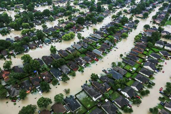 A neighborhood is inundated by floodwaters from Tropical Storm Harvey near east Interstate 10 on Tuesday, Aug. 29, 2017, in Houston. A new survey shows the city's preoccupation with flooding is declining.