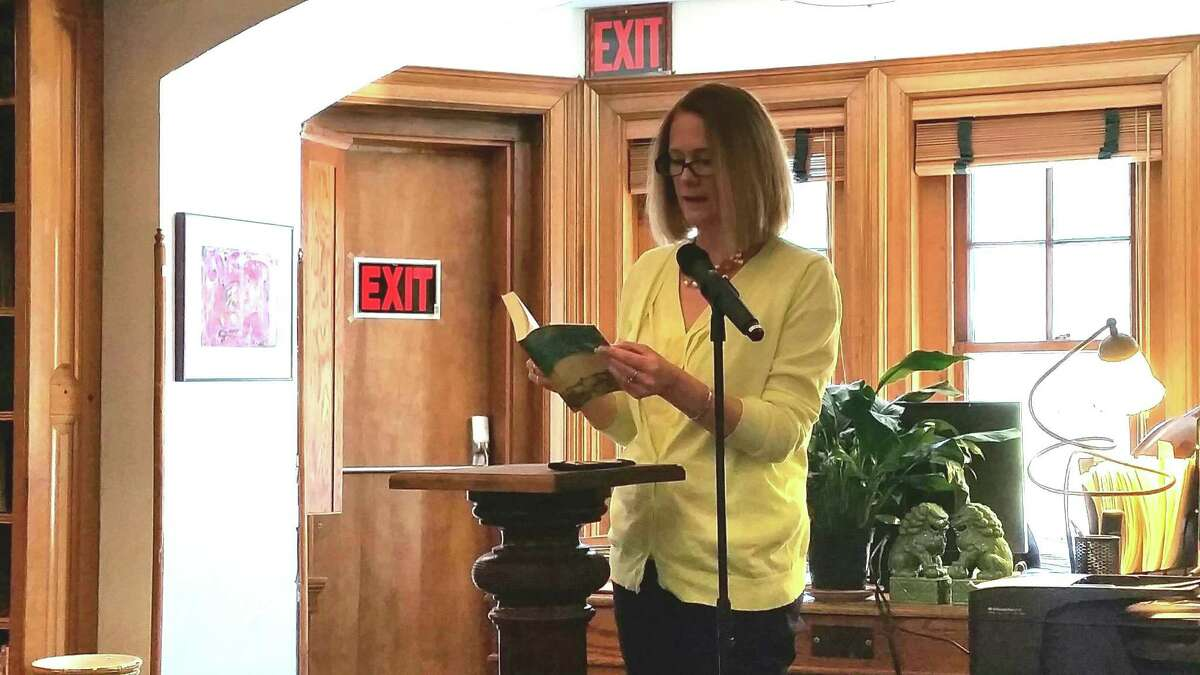 """Sharon Selectwoman Jessica Fowler reads an excerpt from the novel ?""""News of the World?"""" by Paulette Jiles to an audience of 25 people at the Hotchkiss Library of Sharon?'s Reading Jubilee on Saturday."""