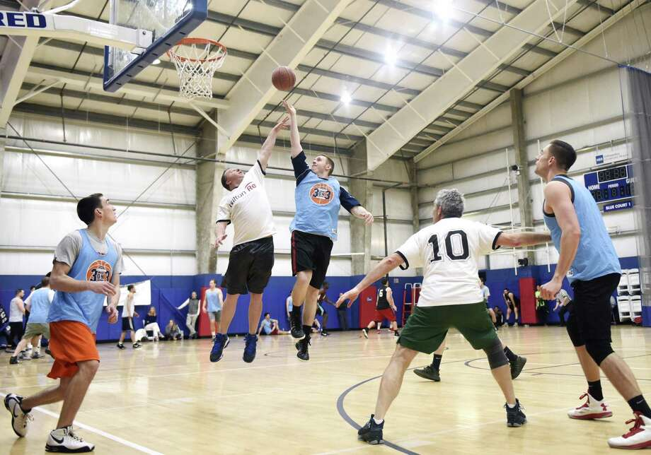 Stamford resident Colin Geary hits a floater over defender Mike Lanuk at the fourth-annual Saint Joseph Parenting Center (SJPC) 3 on 3 Basketball Tournament at Chelsea Piers in Stamford, Conn. Sunday, April 15, 2018. Dozens of teams competed in the double-elimination tournament to raise money for the SPJC and its programs, which include nearly 30 parenting classes and a fatherhood program. Photo: Tyler Sizemore / Hearst Connecticut Media / Greenwich Time