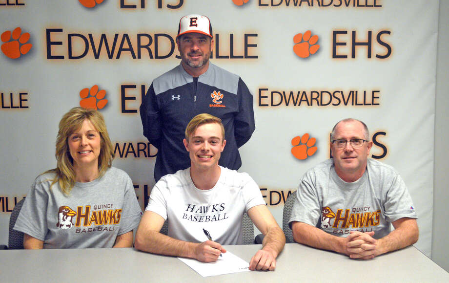 Edwardsville senior Caleb Blakemore will play baseball at Quincy University. In the front row, from left to right, are mother Shannon Blakemore, Caleb Blakemore and father Jack Blakemore. EHS coach Tim Funkhouser is looking on in the back.