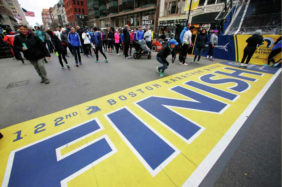 People gather at the Boston Marathon finish line on Sunday in Boston. Photo: Michael Dwyer / Associated Press / AP2018