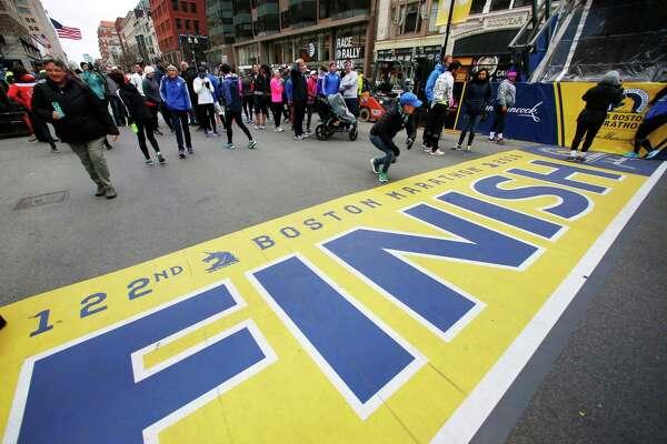 People gather at the Boston Marathon finish line on Sunday in Boston.