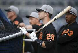 San Francisco Giants' Buster Posey warms up during batting practice prior to a baseball game against the San Diego Padres in San Diego, Thursday, April 12, 2018. (AP Photo/Kelvin Kuo)