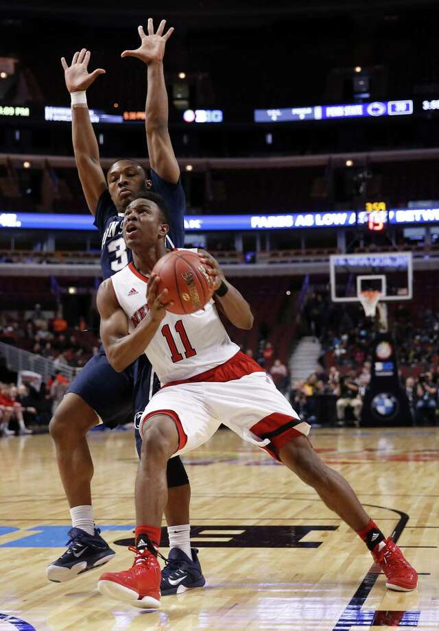 Tarin Smith (11), a graduate transfer who has played at both Duquesne and Nebraska, has committed to play for the Huskies next season. Photo: Associated Press File Photo / AP