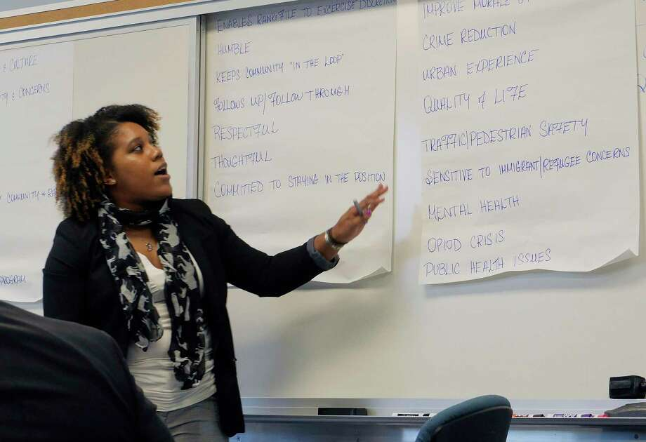Jellisa Joseph, the chief diversity officer for the City of Albany, goes over the ideas that people say they would like to see in a police chief during a community forum held by the City of Albany to get input from the community on what they would like to see in a new police chief, on Sunday, April 15, 2018, at the Capital South Campus Center in Albany, N.Y.  (Paul Buckowski/Times Union) Photo: Albany Times Union / (Paul Buckowski/Times Union)