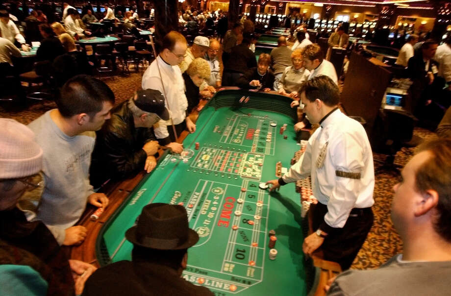 TIMES UNION STAFF PHOTO--MICHAEL P. FARRELL--Crowded craps tables at Turning Stone Casino in Verona , New York December 2002 . Photo: MICHAEL P. FARRELL / ALBANY TIMES UNION