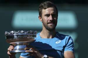 Steve Johnson poses with the U.S. Men's Clay Court Championship trophy at River Oaks Country Club on Sunday, April 15, 2018, in Houston. Johnson defeated Tennys Sandgren, both of United States, for his second title back-to-back 7-6, 2-6 and 6-4. ( Yi-Chin Lee / Houston Chronicle )