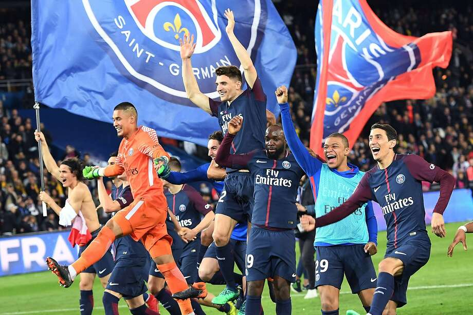 Paris Saint-Germain players celebrate after clinching the French league title in Paris. Photo: Christophe Archambault / AFP / Getty Images