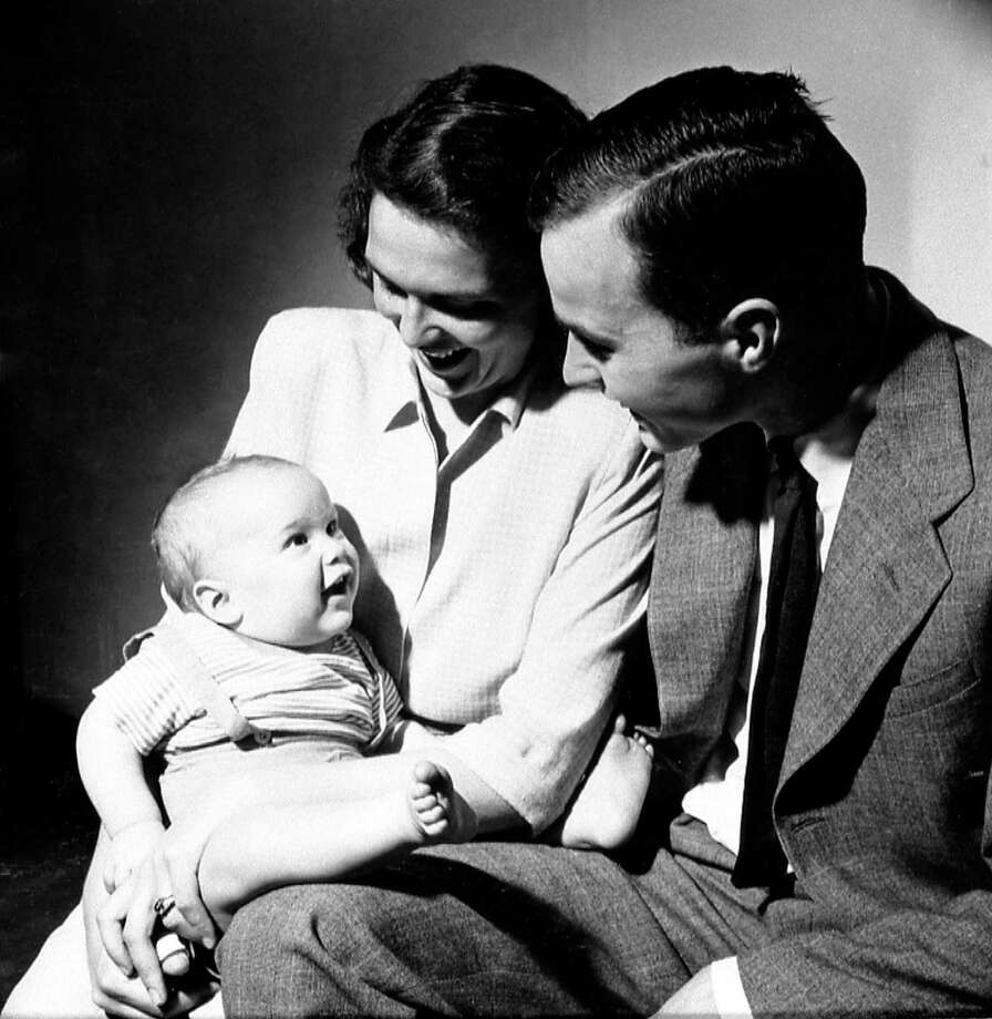 George H. and Barbara Bush with their son, George W., in New Haven, CT, April 1947.