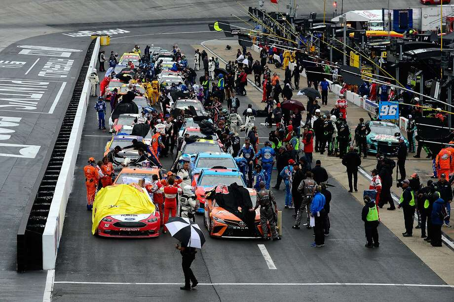 The NASCAR Cup Series field sits on pit road during a red flag rain delay at Bristol Motor Speedway on April 15, 2018 in Bristol, Tenn. The race is scheduled to resume on Monday. Photo: Robert Laberge / Getty Images