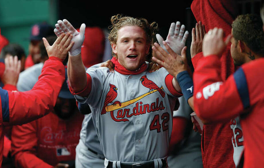 The Cardinals' Harrison Bader celebrates his two-run home run with teammates in the dugout during the second inning Sunday in Cincinnati. Photo:       Associated Press