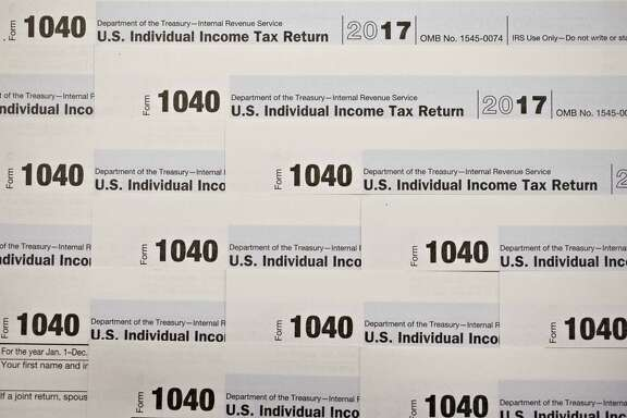 Internal Revenue Service 1040 Individual Income Tax forms for the 2017 tax year. MUST CREDIT: Bloomberg photo by Daniel Acker.