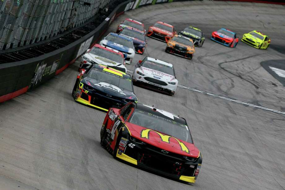 BRISTOL, TN - APRIL 15:  Kyle Larson, driver of the #42 McDonald's Chevrolet, leads agroup of cars during the Monster Energy NASCAR Cup Series Food City 500 at Bristol Motor Speedway on April 15, 2018 in Bristol, Tennessee.  (Photo by Sean Gardner/Getty Images) Photo: Sean Gardner / 2018 Getty Images
