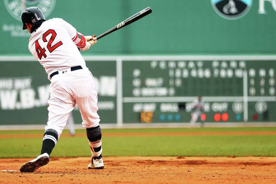 BOSTON, MA - APRIL 15:  Brock Holt #12 of the Boston Red Sox bats in the second inning during a game against the Baltimore Orioles at Fenway Park on April 15, 2018 in Boston, Massachusetts. All players are wearing #42 in honor of Jackie Robinson Day. (Photo by Adam Glanzman/Getty Images) Photo: Adam Glanzman / 2018 Getty Images