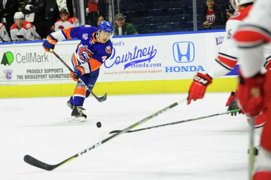 Bridgeport Sound Tigers defenseman fires a shot towards goal during a game against the Charlotte Checkers inside Webster Bank Arena in Bridgeport, Conn. on Sunday, April 15, 2018. Photo: Michael Cummo / Hearst Connecticut Media / Stamford Advocate