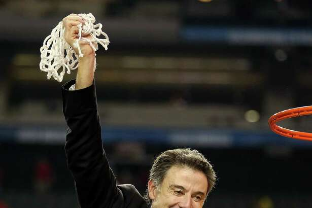 FILE - SEPTEMBER 27:Coach Rick Pitino and Athletic director Tom Jurich Let Go From Louisville - ATLANTA, GA - APRIL 08:  Head coach Rick Pitino of the Louisville Cardinals celebrates with the net after cutting it down following their 82-76 win against the Michigan Wolverines during the 2013 NCAA Men's Final Four Championship at the Georgia Dome on April 8, 2013 in Atlanta, Georgia.  (Photo by Andy Lyons/Getty Images) ORG XMIT: 162873864