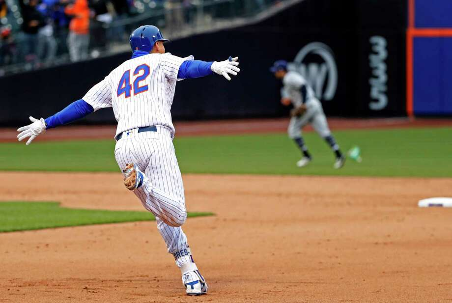 New York Mets Wilmer Flores runs the bases after hitting a walk-off, solo home run in the ninth inning of a baseball game against the Milwaukee Brewers, Sunday, April 15, 2018, in New York. (AP Photo/Kathy Willens) Photo: Kathy Willens / Associated Press