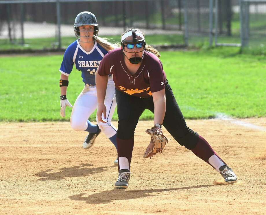 Colonie's Sarah Baluch (12) fields a base hit infront of Shaker's Alissa Folts (11) during a Section II Class AA girls high school softball game in Colonie, N.Y., Friday, April 28, 2017. (Hans Pennink / Special to the Times Union) ORG XMIT: HP107 Photo: Hans Pennink / 20040372A