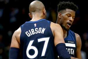 NEW ORLEANS, LA - NOVEMBER 01:  Jimmy Butler #23 of the Minnesota Timberwolves reacts with Taj Gibson #67 of the Minnesota Timberwolves after scoring a three pointer during the fourth quarter against the New Orleans Pelicans  at the Smoothie King Center on November 1, 2017 in New Orleans, Louisiana. NOTE TO USER: User expressly acknowledges and agrees that, by downloading and or using this photograph, User is consenting to the terms and conditions of the Getty Images License Agreement.  Minnesota won the game 104 -98.  (Photo by Sean Gardner/Getty Images)