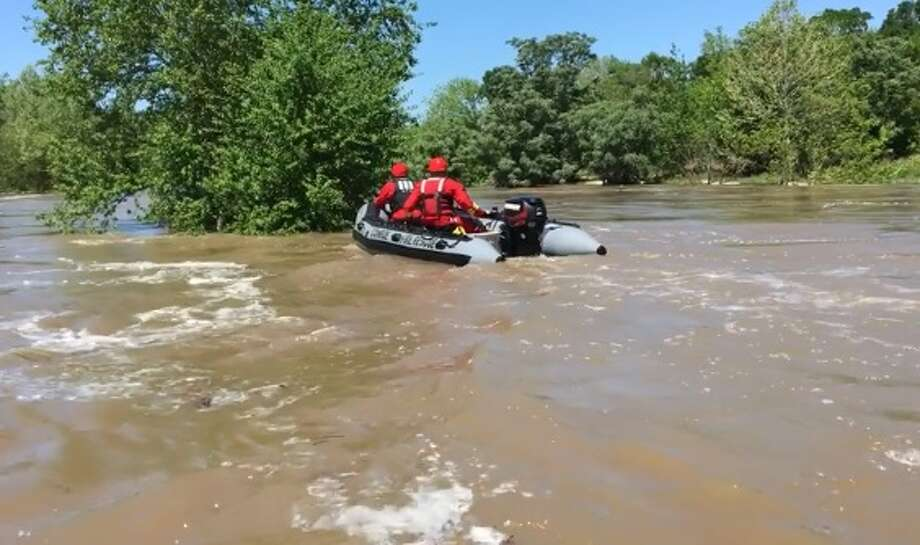 When four inches of rain fell over the Montgomery County area a few weeks ago, the swollen San Jacinto River that had risen out of its banks was the perfect site for swift water training for the Conroe Fire Department. Photo: Conroe Fire Department