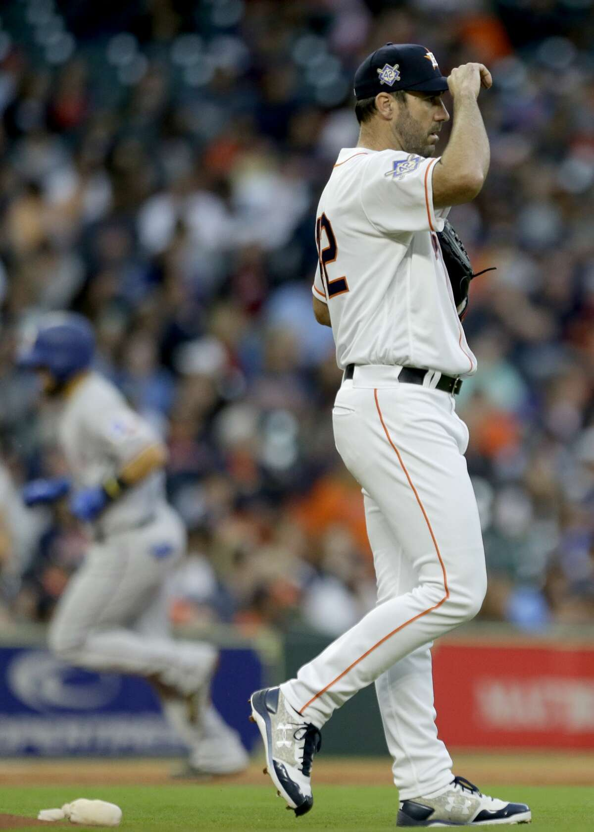 Houston Astros pitcher Justin Verlander reacts as Texas Rangers Robinson Chirinos rounds the bases on his home run during the third inning of game at Minute Maid Park Sunday, April 15, 2018, in Houston. ( Melissa Phillip / Houston Chronicle )