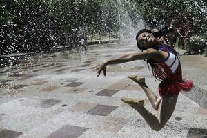 Faith Ward, a junior Ramette at Kashmere High School, poses for a photo in the splash pad during Discovery Green's 10th year celebration on Sunday, April 15, 2018, in Houston. The Houston schoo's marching band performed during the celebration.  ( Elizabeth Conley / Houston Chronicle )